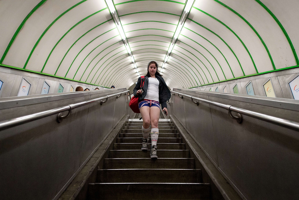 ". A participant in the13th annual International ""No Pants Subway Ride\"" enters a London underground station in London, on January 12, 2014. Starting in 2002 with only seven participants, the day is now marked in over 60 cities around the world.  The idea behind \""No Pants\"" is that random passengers board a subway car at separate stops in the middle of winter, without wearing trousers. The participants wear all of the usual winter clothing on their top half such as hats, scarves and gloves and do not acknowledge each other\'s similar state of undress. LEON NEAL/AFP/Getty Images"
