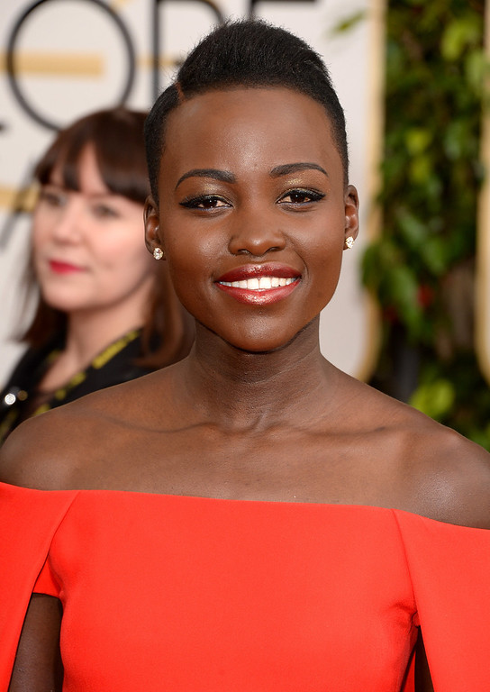 Description of . Actress Lupita Nyong\'o attends the 71st Annual Golden Globe Awards held at The Beverly Hilton Hotel on January 12, 2014 in Beverly Hills, California.  (Photo by Jason Merritt/Getty Images)