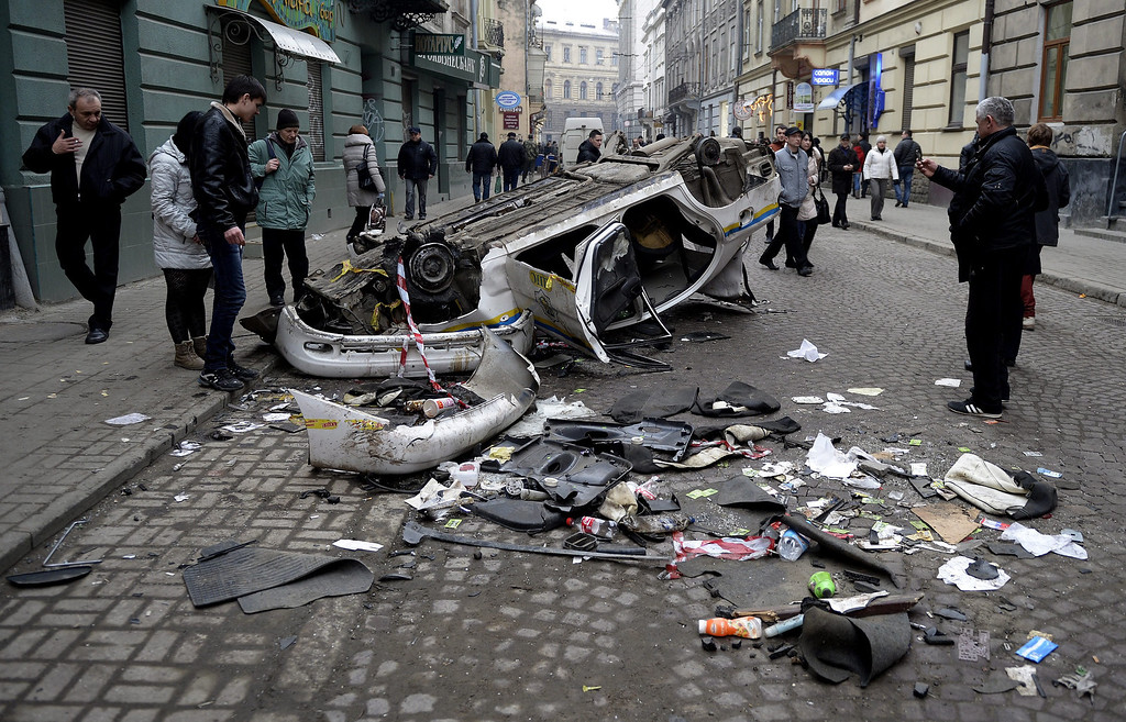 Description of . The toppled wreck of the police car is seen in a downtown street in Lviv, Ukraine, 19 February 2014 after a night of anti-government demonstrations in the western Ukrainian city.  EPA/Darek Delmanowicz