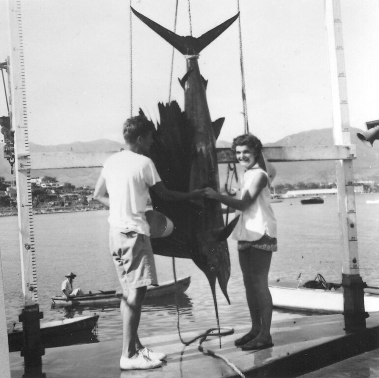 Description of . The newlyweds admire a sailfish the senator caught during their honeymoon in Acapulco in September 1953. John F. Kennedy Presidential Library and Museum