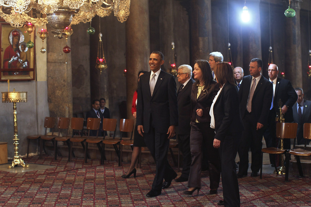 Description of . U.S. President Barack Obama (L) visits the Church of the Nativity with Palestinian President Mahmoud Abbas (2L) on March 22, 2013 in Bethlehem, West Bank.  (Photo by Atef Safadi-Pool/Getty images)