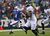 Ryan Fitzpatrick #14 of the Buffalo Bills runs for a first down against the Jacksonville Jaguars at Ralph Wilson Stadium on December 2, 2012 in Orchard Park, New York.  (Photo by Rick Stewart/Getty Images)