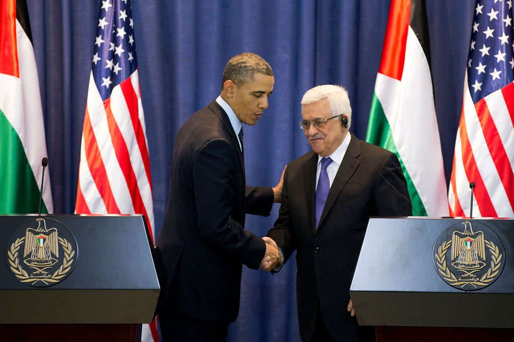 Description of . U.S. President Barack Obama and Palestinian President Mahmoud Abbas shake hands during a joint news conference at the Muqata Presidential Compound, Thursday, March 21, 2013, in the West Bank town of Ramallah. (AP Photo/Carolyn Kaster)