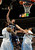 Memphis Grizzlies center Marc Gasol, center, of Spain, shoots between Denver Nuggets forwards Wilson Chandler, left, and JaVale McGee in the first quarter of an NBA basketball game in Denver, Friday, March 15, 2013. (AP Photo/David Zalubowski)