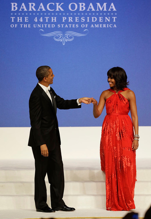 Description of . President Barack Obama and first lady Michelle Obama dance at Commander-in-Chief's Inaugural Ball at the 57th Presidential Inauguration in Washington, Monday, Jan. 21, 2013. (AP Photo/Jacquelyn Martin)