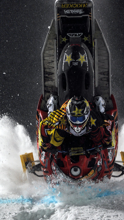 Description of . In this photo taken Jan. 24, 2013, Caleb Moore crashes during the snowmobile freestyle finals at the Winter X Games in Aspen, Colo. (AP Photo/The Colorado Springs Gazette, Christian Murdock)