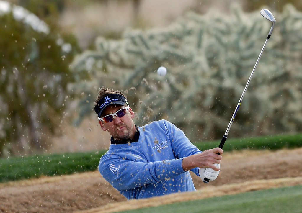 Description of . England\'s Ian Poulter hits out of a bunker onto the 16th green during the first round of the Match Play Championship golf tournament, Thursday, Feb. 21, 2013, in Marana, Ariz. (AP Photo/Julie Jacobson)