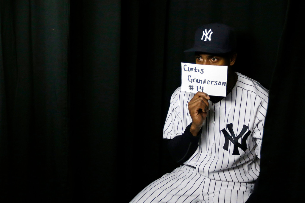 Description of . New York Yankees center fielder Curtis Granderson poses in a photo booth during the team's photo day at baseball spring training, Wednesday, Feb. 20, 2013, in Tampa, Fla. (AP Photo/Matt Slocum)