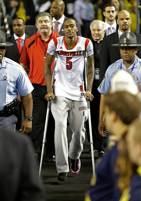 Description of . Louisville guard Kevin Ware walks out to the court before the first half of the NCAA Final Four tournament college basketball championship game against the Michigan, Monday, April 8, 2013, in Atlanta. (AP Photo/David J. Phillip)