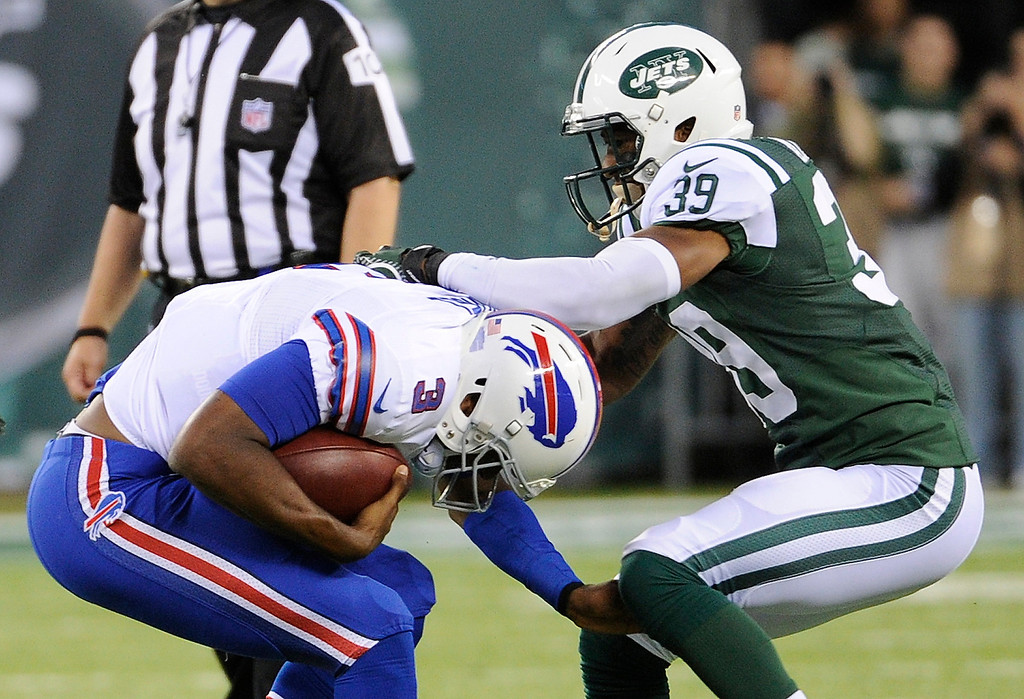 . New York Jets free safety Antonio Allen sacks Buffalo Bills quarterback EJ Manuel (3) during the second half of an NFL football game Sunday, Sept. 22, 2013, in East Rutherford, N.J. (AP Photo/Bill Kostroun)