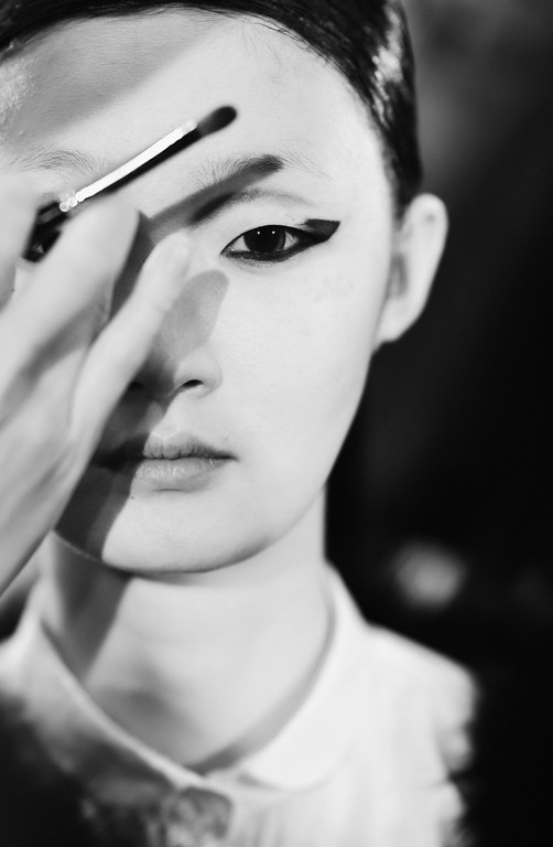 Description of . A model backstage before the Tsumori Chisato Fall/Winter 2013 Ready-to-Wear show as part of Paris Fashion Week on March 2, 2013 in Paris, France.  (Photo by Gareth Cattermole/Getty Images)