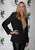 Actress Daryl Hannah poses at 