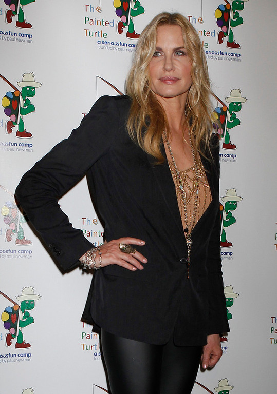 Description of . Actress Daryl Hannah poses at