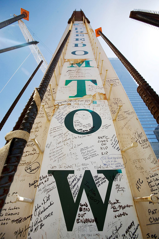 Description of . In this May 30, 2007 file photo, a steel column for the Freedom Tower bears signatures of Sept. 11 victims' family members at the World Trade Center in New York. Their signatures join those left by some who worked on the towers. Construction workers have left personal messages on One World Trade Center in the form of graffiti. (AP Photo/Mark Lennihan, File)
