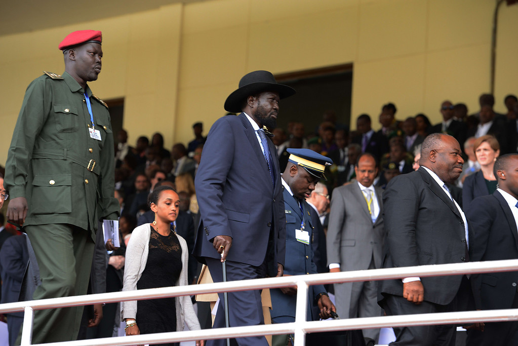Description of . South Sudan's President Salva Kiir (C) arrives at the Amahoro stadium, in Kigali, on April 7,2014, during a ceremony marking the 20th anniversary of Rwanda's genocide. Rwandan President Paul Kagame took a thinly-veiled swipe at France on April 7, saying it was impossible to