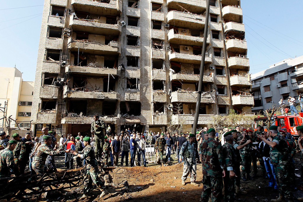 . Lebanese policemen inspect the scene of two suicide explosions near the Iranian embassy in south Beirut, Lebanon, 19 November 2013.  EPA/NABIL MOUNZER