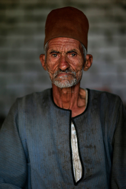 Description of . Egyptian farmer Mahmoud Hussein, 75, stands in his house in Qalubiyah, North Cairo, Egypt on Saturday, July 13, 2013. When asked: As you grow older, what are you most afraid of and what is the biggest problem facing the elderly in your country? Hussein said,