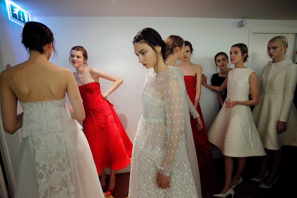 Description of . Models wait backstage prior to the Valentino  Spring Summer 2013 Haute Couture fashion collection, presented in Paris, Wednesday, Jan. 23, 2013. (AP Photo/Christophe Ena)