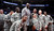 NBA great Shaquille O'Neal poses with U.S. military personnel before the start of the NBA BBVA Rising Star Challenge basketball game in Houston, Texas, February 15, 2013. REUTERS/Lucy Nicholson