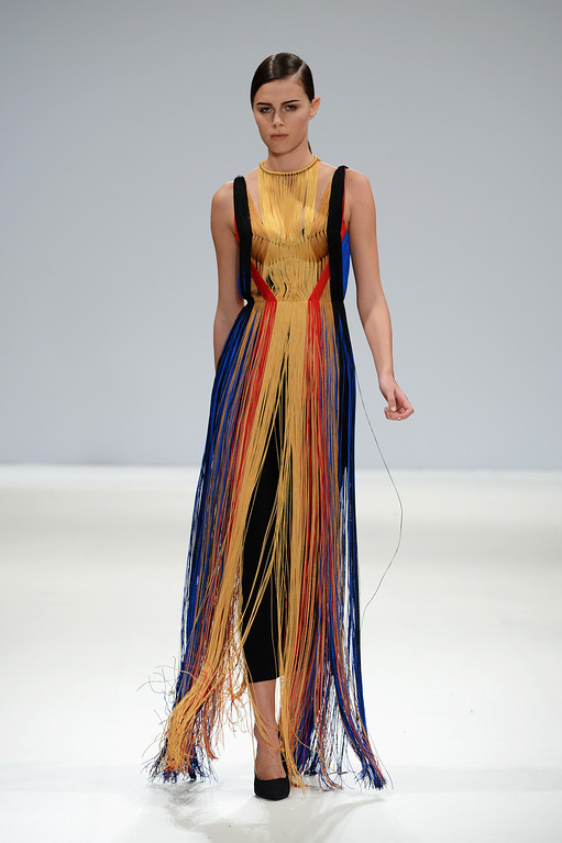 Description of . LONDON, ENGLAND - FEBRUARY 16:  A model wearing a design by Yulia Kondanina walks the runway at the Ones To Watch show during London Fashion Week Fall/Winter 2013/14 at Freemasons Hall on February 16, 2013 in London, England.  (Photo by Samir Hussein/Getty Images)