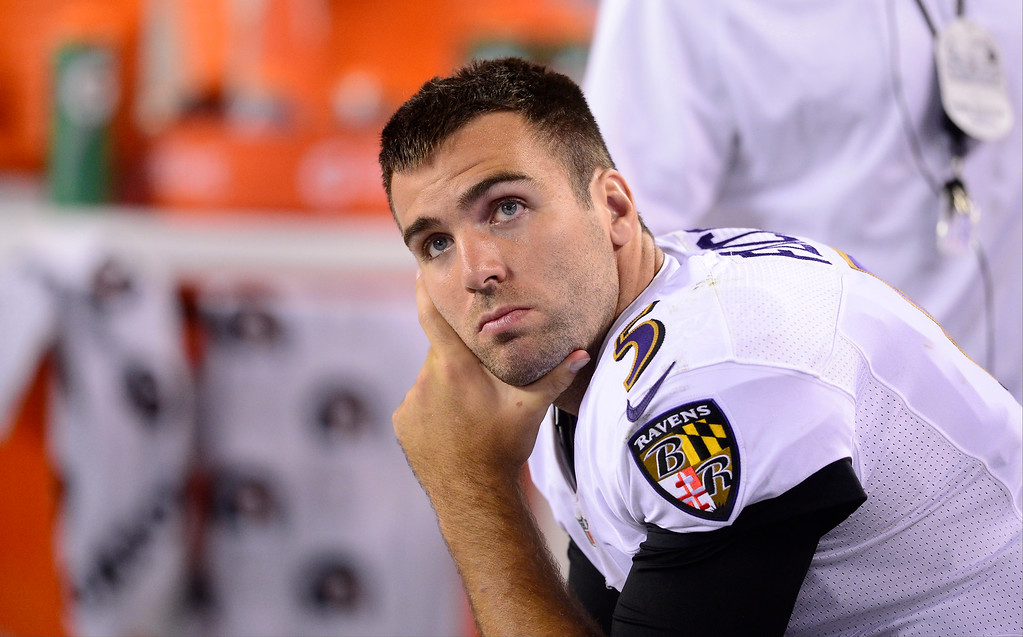 Description of . Baltimore Ravens quarterback Joe Flacco (5) sits on the sidelines in the third quarter. The Denver Broncos took on the Baltimore Ravens in the first game of the 2013 season at Sports Authority Field at Mile High in Denver on September 5, 2013. (Photo by AAron Ontiveroz/The Denver Post)