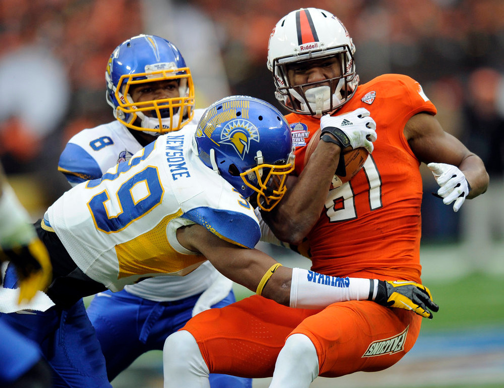 Description of . San Jose State safety Cullen Newsome (39) tackles Bowling Green wide receiver Chris Gallon (81) during the first half of the Military Bowl NCAA college football game, Thursday, Dec. 27, 2012, in Washington. (AP Photo/Nick Wass)