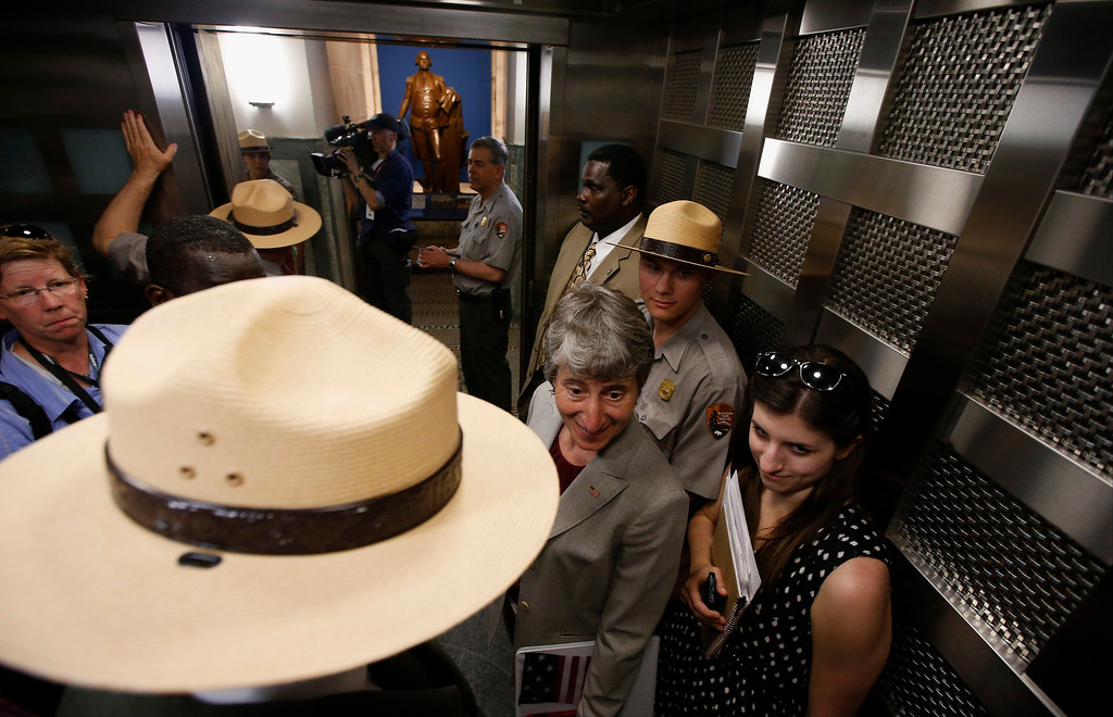 . Interior Secretary Sally Jewell, center, rides an elevator to the 500-foot level at the Washington Monument in Washington, Monday, May 12, 2014, after a ceremony to celebrate its re-opening.  (AP Photo)