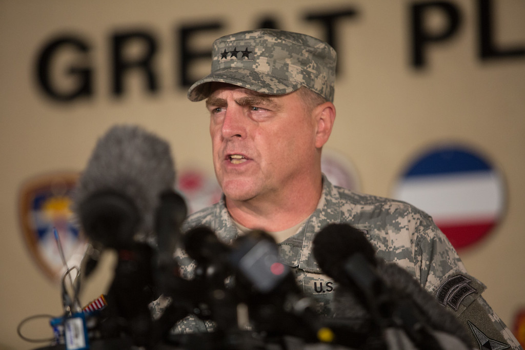 Description of . Lt. Gen. Mark Milley, the senior officer on base, speaks with the media outside of an entrance to the Fort Hood military base following a shooting that occurred inside, Wednesday, April 2, 2014, in Fort Hood, Texas. Four people were killed, including the gunman, and 16 were wounded in the attack, authorities said. (AP Photo/Tamir Kalifa)
