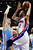 Detroit Pistons forward Tayshaun Prince (22) goes to the basket against Denver Nuggets center Timofey Mozgov (25) in the first half of an NBA basketball game, Tuesday, Dec. 11, 2012, in Auburn Hills, Mich. (AP Photo/Duane Burleson)