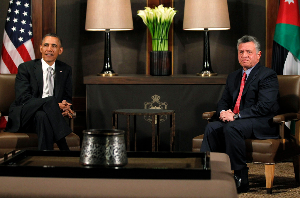 Description of . U.S. President Barack Obama (L) participates in a bilateral meeting with Jordan's King Abdullah II at Al-Hummar Palace, in Amman March 22, 2013. REUTERS/Jason Reed