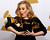 Singer Adele holds her six Grammy Awards at the 54th annual Grammy Awards in Los Angeles, California February 12, 2012. Soul singer Adele triumphed in her return to music's stage on Sunday, scooping up six Grammys and winning every category in which she was nominated including album of the year for