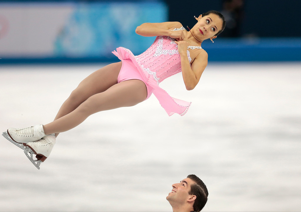 Description of . Felicia Zhang and Nathan Bartholomay of the United States compete in the pairs short program figure skating competition at the Iceberg Skating Palace during the 2014 Winter Olympics, Tuesday, Feb. 11, 2014, in Sochi, Russia. (AP Photo/Ivan Sekretarev)
