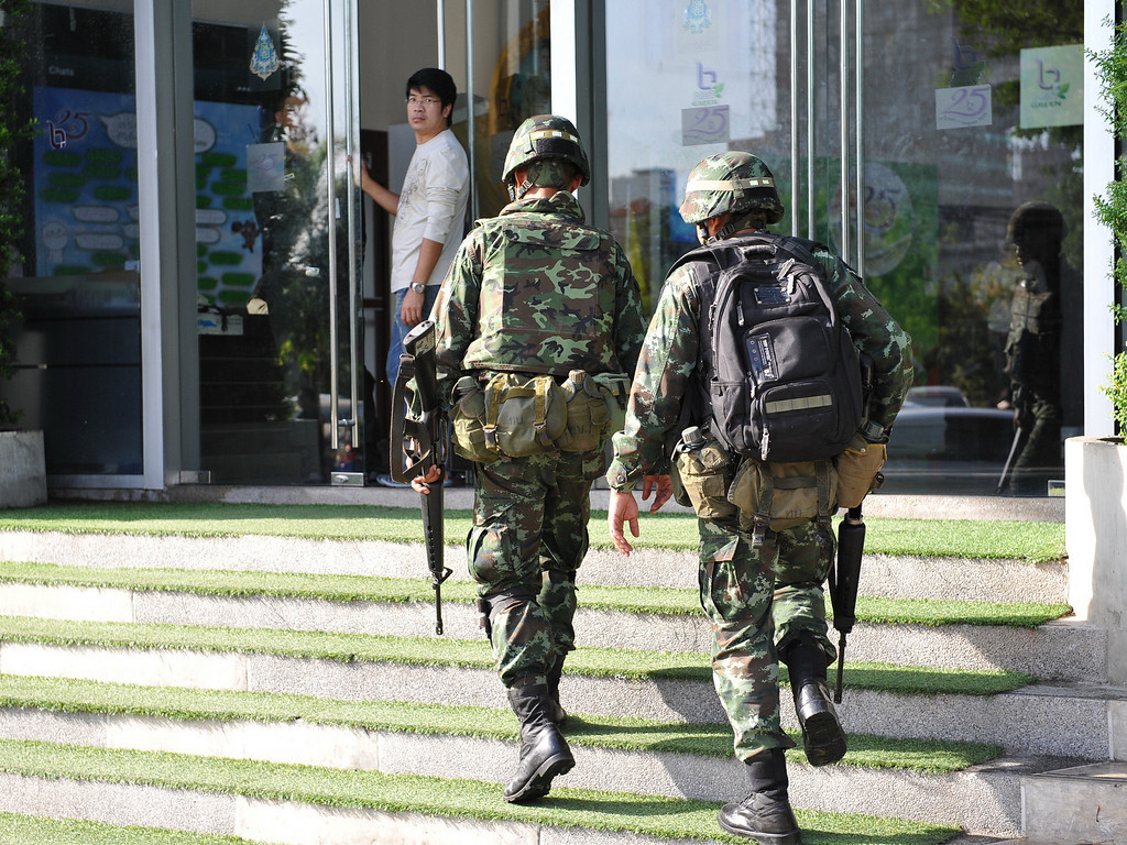 Description of . Thai army soldiers enter the offices of the National Broadcasting Services of Thailand after martial law was declared on May 20, 2014 in Bangkok, Thailand. (Photo by Rufus Cox/Getty Images)
