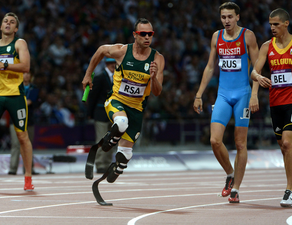 Description of . South Africa's Oscar Pistorius runs the final leg for South Africa for the Men's 4x400m Relay at the Olympic Stadium for the London 2012 Olympics in London, England on Friday, Aug. 10, 2012.  (Nhat V. Meyer/Mercury News)