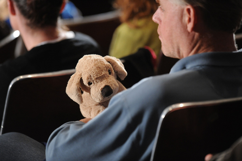 Description of . A man holds a stuffed toy before U.S. President Barack Obama arrives to speak at a memorial service for victims of the Sandy Hook Elementary School shooting at Newtown High School in Newtown, Connecticut, U.S., on Sunday, Dec. 16, 2012. Obama arrived in Newtown, Connecticut, two days after the tragedy and as authorities were still trying to piece together a motive for the second-deadliest mass shooting in the U.S. Photographer: Olivier Douliery/Pool via Bloomberg