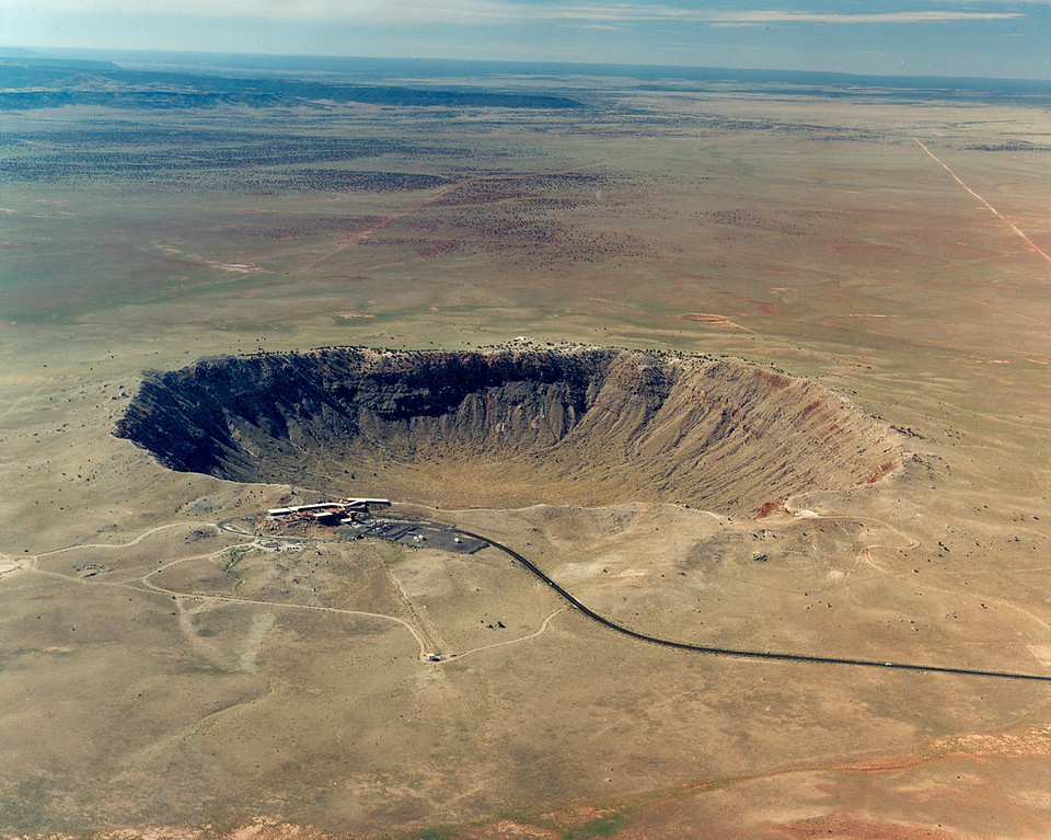 Description of . This undated image courtesy of Meteor Crater, Northern Arizona, USA, shows an aerial view of Meteor Crater, near Winslow, Ariz. The world's best-preserved meteor impact site is an intriguing piece of natural history. Nearly a mile wide and over 550 feet deep, the crater isn't close to being the largest in the world _ Vredefort Dome in South Africa is over 180 miles wide _ but is impressive because limited erosion has left it virtually intact.     (AP Photo/Meteor Crater, Northern Arizona, USA.)