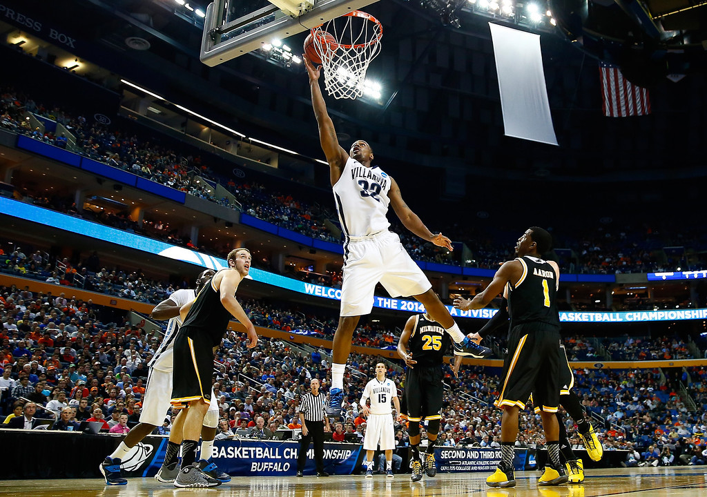 Description of . BUFFALO, NY - MARCH 20:  James Bell #32 of the Villanova Wildcats goes to the basket against the Milwaukee Panthers during the second round of the 2014 NCAA Men's Basketball Tournament at the First Niagara Center on March 20, 2014 in Buffalo, New York.  (Photo by Jared Wickerham/Getty Images)