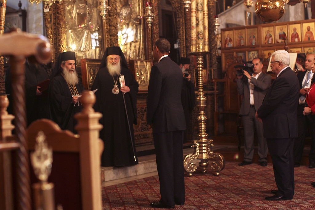 Description of . U.S. President Barack Obama (L) visits the Church of the Nativity with Palestinian President Mahmoud Abbas on March 22, 2013 in Bethlehem, West Bank. (Photo by Atef Safadi-Pool/Getty images)