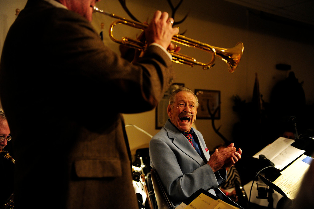 Description of . Gordon Dooley, 91, smiles as his trumpeter Charlie Smith plays a solo during The Battle of the Big Bands, a fundraiser hosted at the Lakewood Elks Lodge on Sunday, September 16 2012. Dooley came out of retirement two days after his 91st birthday to lead his group. Proceeds from the event will be donated to the West Metro Fire and Rescue Foundation. AAron Ontiveroz, The Denver Post