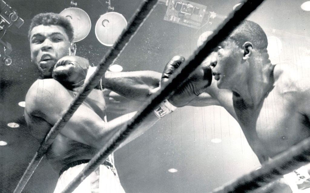 Description of . It wasn't all Clay, though, despite the fact he claimed the title in one of boxing's biggest upsets.  Clay took his share of punches as shown in this fifth-round action as a right hand smash by Liston turns his head.  Liston had decided edge in round.  1964. Denver post Library Archive