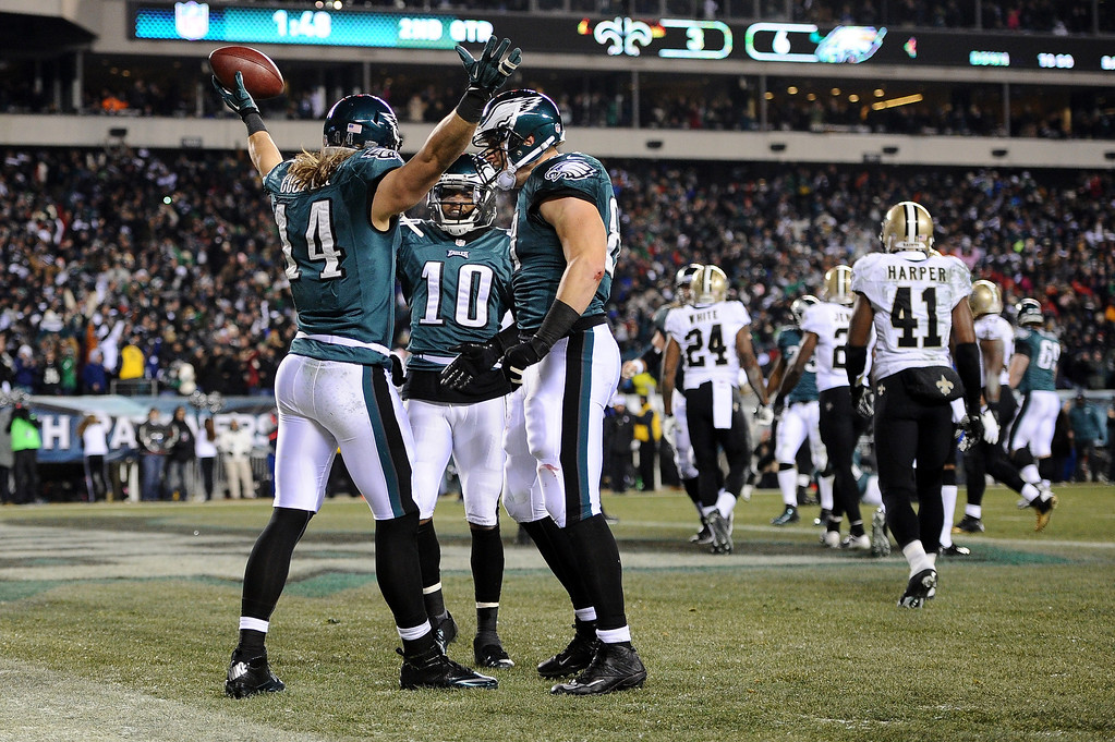 Description of . PHILADELPHIA, PA - JANUARY 04:  Riley Cooper #14 of the Philadelphia Eagles celebrates with his teammates  DeSean Jackson #10 and  Brent Celek #87 after scoing a 10 yard touchdown thrown by Nick Foles #9 in the second quarter against the New Orleans Saints during their NFC Wild Card Playoff game at Lincoln Financial Field on January 4, 2014 in Philadelphia, Pennsylvania.during their NFC Wild Card Playoff game at Lincoln Financial Field on January 4, 2014 in Philadelphia, Pennsylvania.  (Photo by Maddie Meyer/Getty Images)