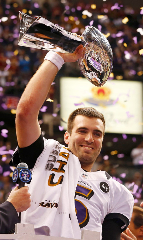 Description of . Baltimore Ravens quarterback Joe Flacco celebrates with the Vince Lombardi trophy after the Ravens defeated the San Francisco 49ers to win the NFL Super Bowl XLVII football game in New Orleans, Louisiana, February 3, 2013. REUTERS/Jeff Haynes