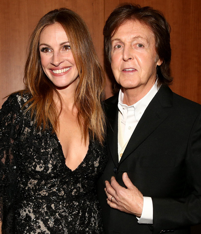 Description of . Actress Julia Roberts and musician Sir Paul McCartney onstage during the 56th GRAMMY Awards at Staples Center on January 26, 2014 in Los Angeles, California.  (Photo by Christopher Polk/Getty Images for NARAS)