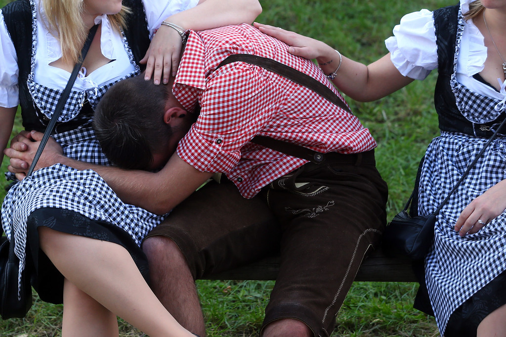 Description of . People rest on a meadow during day 1 of the Oktoberfest 2013 beer festival at Theresienwiese on September 21, 2013 in Munich, Germany.  (Photo by Alexander Hassenstein/Getty Images)