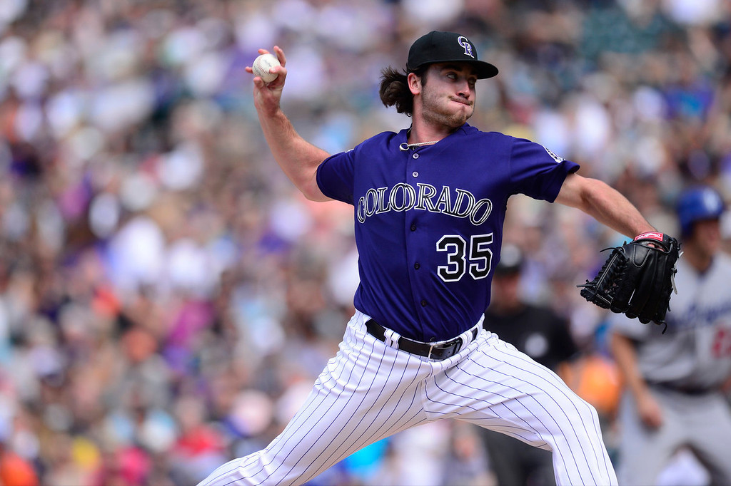 Description of . Chad Bettis (35) of the Colorado Rockies fires a pitch during the action in Denver on Monday, September 2, 2013. The Colorado Rockies hosted the Los Angeles Dodgers at Coors Field.   (Photo by AAron Ontiveroz/The Denver Post)
