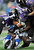 Indianapolis Colts wide receiver Reggie Wayne (87) is tackled by Baltimore Ravens cornerback Cary Williams, left, strong safety Bernard Pollard, and inside linebacker Ray Lewis, top, during the first half of an NFL wild card playoff football game Sunday, Jan. 6, 2013, in Baltimore. (AP Photo/Nick Wass)
