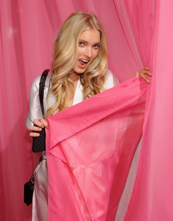Description of . Elsa Hosk prepares at the 2013 Victoria's Secret Fashion Show hair and makeup room at Lexington Avenue Armory on November 13, 2013 in New York City.  (Photo by Jamie McCarthy/Getty Images)