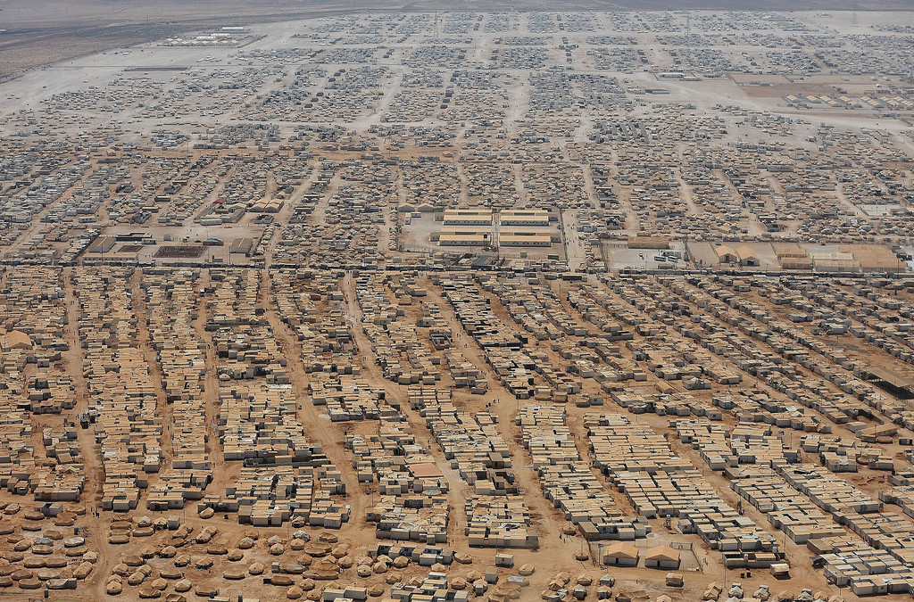 Description of . An aerial view shows the Zaatari refugee camp on July 18, 2013 near the Jordanian city of Mafraq, near the Jordanian-Syrian border.  The refugee camp is home to 115,000 Syrians.  MANDEL NGAN/AFP/Getty Images
