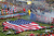 A large United States flag is unfurled during pre-race ceremonies prior to the start of the Daytona 500 at the Daytona International Speedway in Daytona Beach, Fla., on Sunday, Feb. 20, 2005. (AP Photo/David Graham)