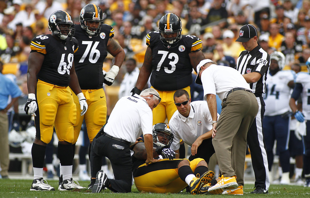 Description of . Maurkice Pouncey #53 of the Pittsburgh Steelers is tended to by medical staff in the first half during the game against the Tennessee Titans on September 8, 2013 at Heinz Field in Pittsburgh, Pennsylvania.  (Photo by Justin K. Aller/Getty Images)